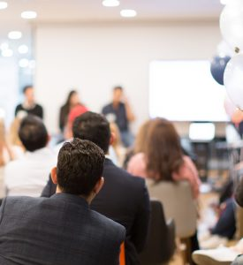 Conference,Photo,Audience,And,Speaker,Giving,Speech.,Seminar,Presenter,On